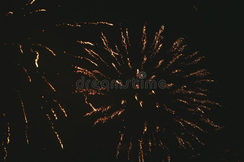 Close-up gold festive fireworks on a black background. Abstract holiday background. Victory day. 9 March 2019 stock photo
