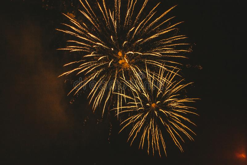Close-up gold festive fireworks on a black background. Abstract holiday background. Victory day. 9 March 2019 royalty free stock image
