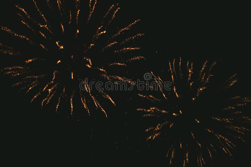 Close-up gold festive fireworks on a black background. Abstract holiday background. Victory day. 9 March 2019 royalty free stock photos