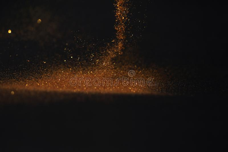 Close up of Gold powder with glitter lights on dark background royalty free stock images