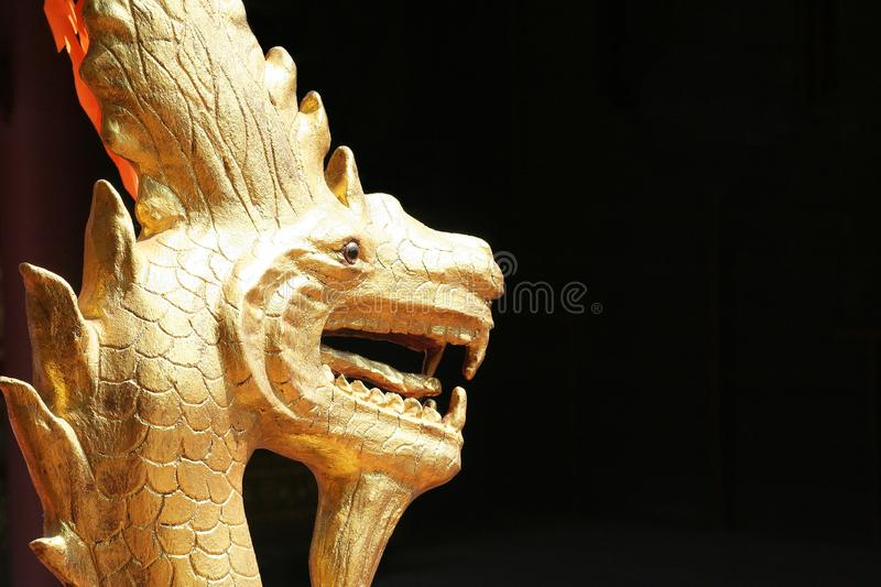 Gold snake statue. Close up Gold snake statue royalty free stock photography