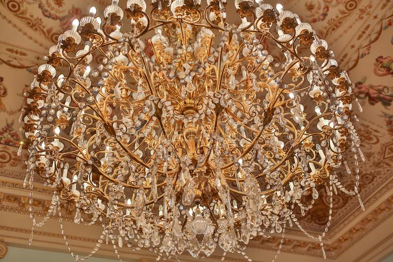 Close up of golden chandelier lamp at Colon Theatre.  stock images