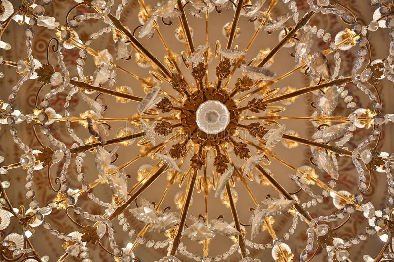 Close up of golden chandelier lamp at Colon Theatre.  royalty free stock photography