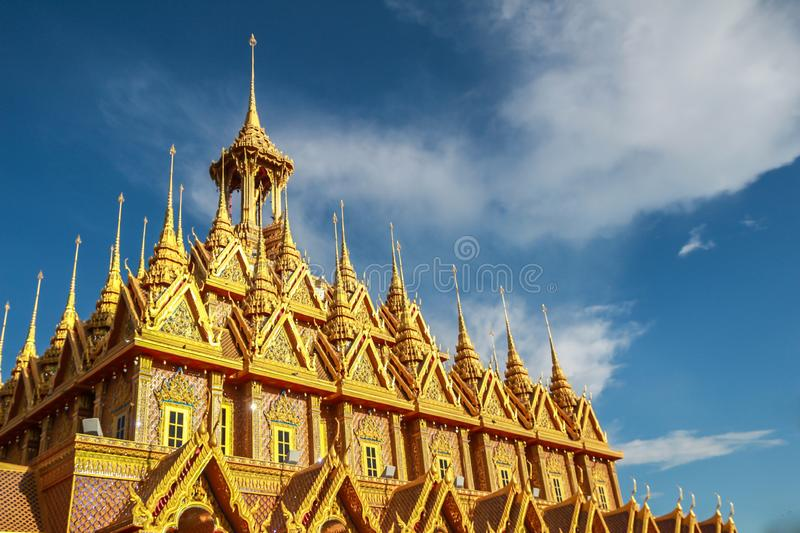 Golden pagoda with blue sky at Wat Tha Sung in Uthai Thani, Thailand royalty free stock photos