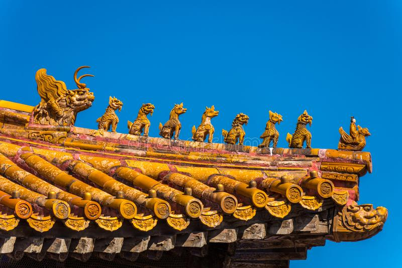 Close-up of the golden tiles rooftops of The Forbidden City,the former Chinese imperial palace from the Ming dynasty to the end of. The Qing dynasty, the stock photography