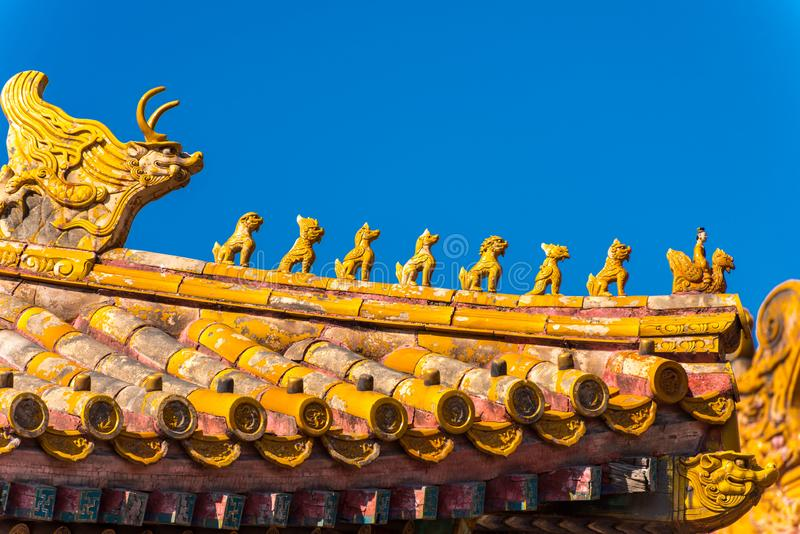 Close-up of the golden tiles rooftops of The Forbidden City,the former Chinese imperial palace from the Ming dynasty to the end of. The Qing dynasty, the stock photos