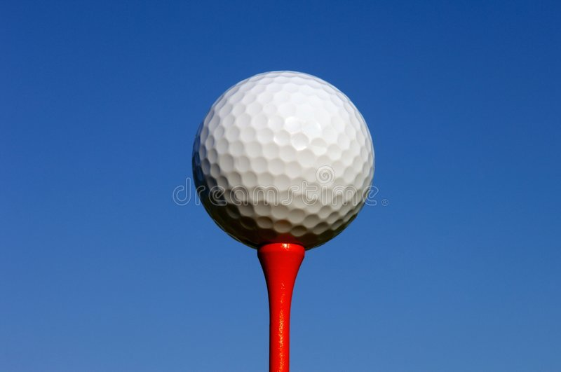 Close up of a golf ball on a tee royalty free stock photos