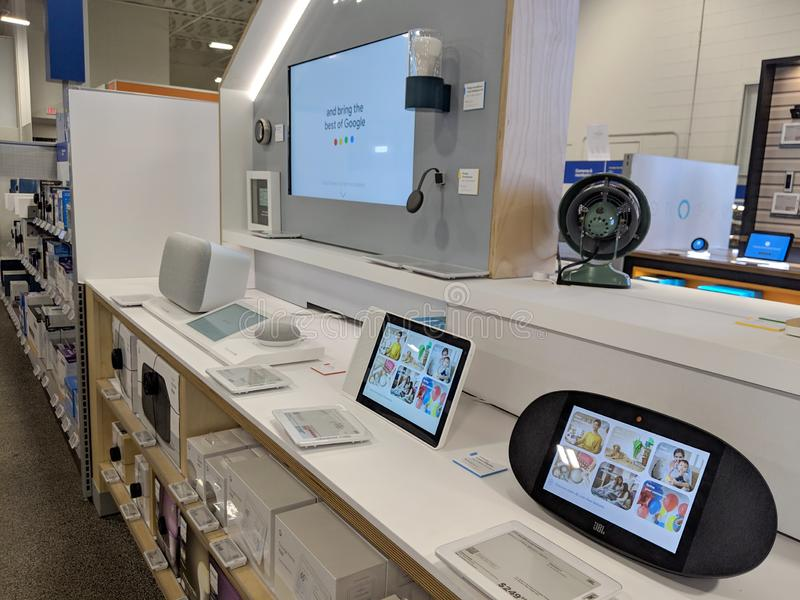 Close-up of Google Home, Mini, Max, other devices, and Logo on Display inside Best Buy Store. Honolulu -  March 16, 2019:  Close-up of Google Home, Mini, Max royalty free stock photos