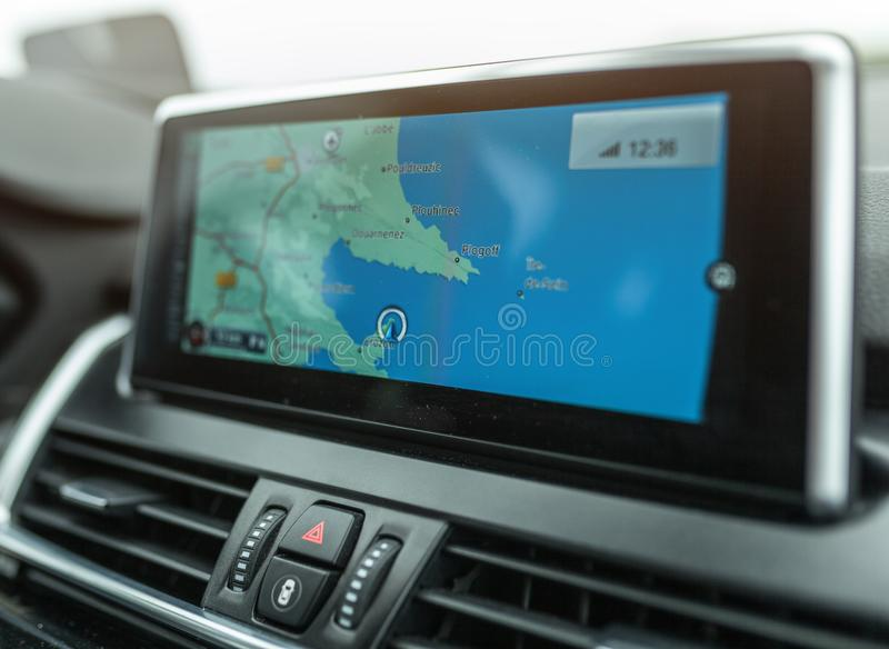 Close-up of gps navigation system device in travelling car.  royalty free stock photo