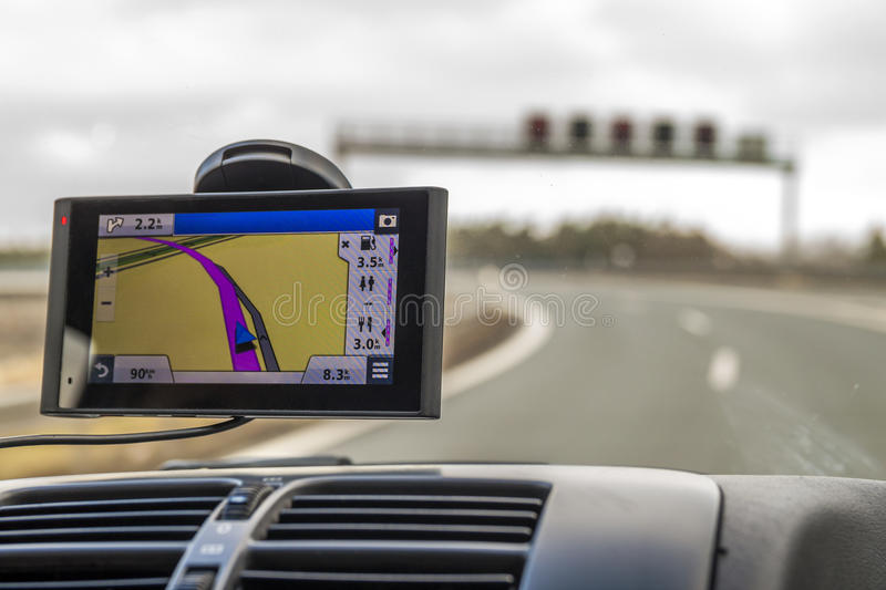 Close-up of gps navigation system device in travelling car stock photo