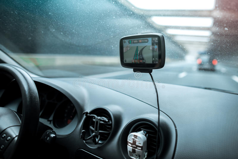 Close-up of gps navigation system In old car.  stock images