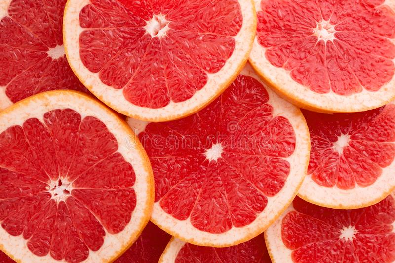 Close-up Grapefruit slices abstract background in Living Coral color royalty free stock photos