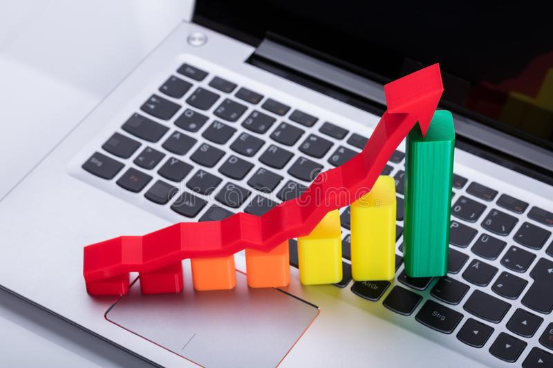 Close-up Of Graph And Arrow Sign Showing Upward Direction. On Computer Keyboard stock photography