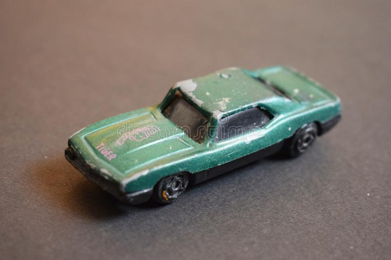 Close up of green coloured destroyed toy car. stock photo