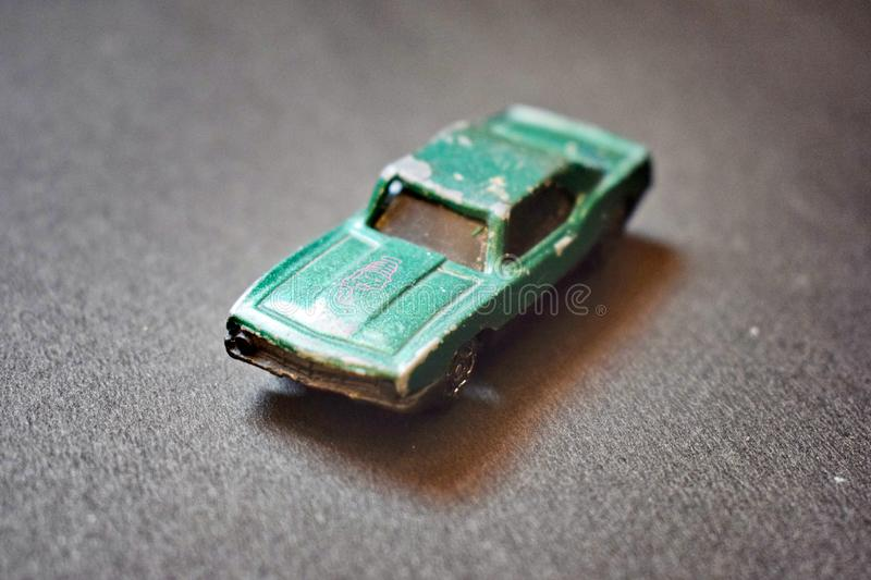 Close up of green coloured destroyed toy car. stock photography