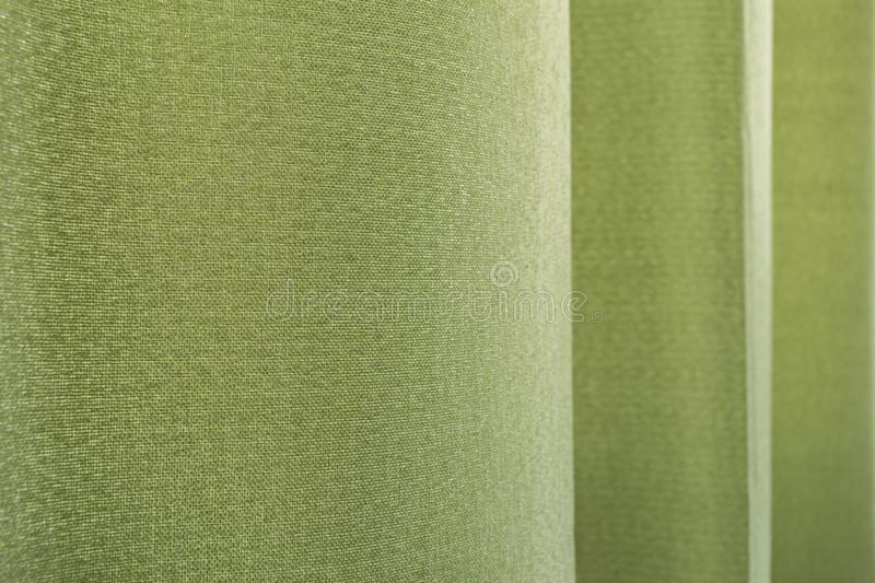 Green curtain texture background. Close-up green curtain texture background in bed room or living room stock images