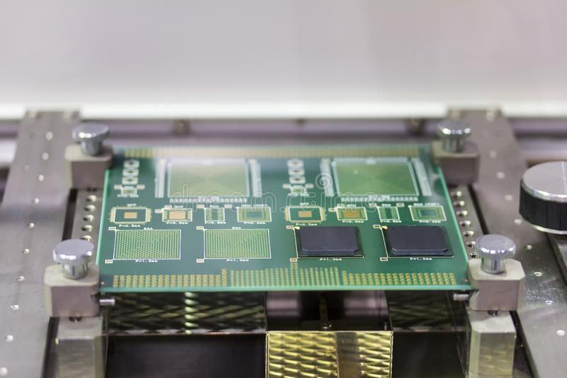 Close up green electronic printed circuit board pcb for computer or equipment setup on jig at work table stock image