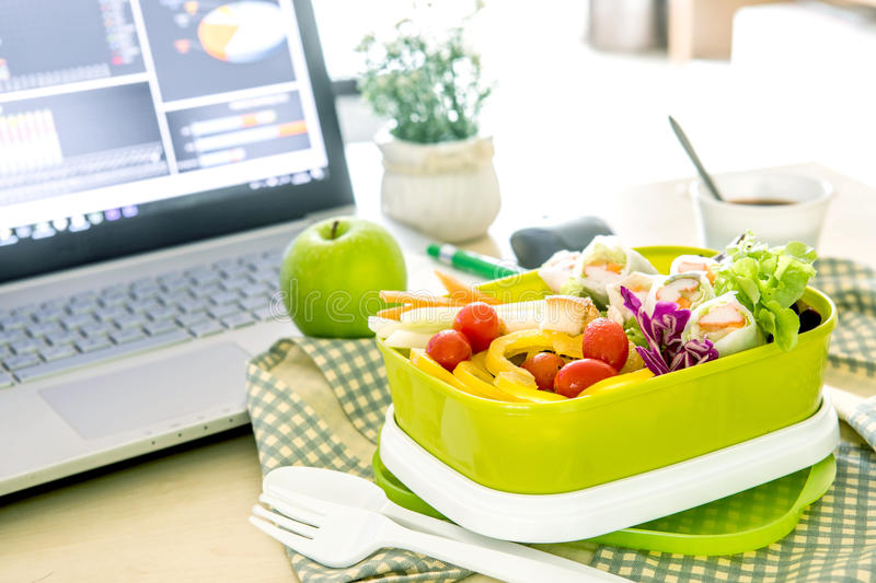 Close up green Lunch box on the work place of working desk ,Healthy eating clean food habits for diet and health care concept royalty free stock images