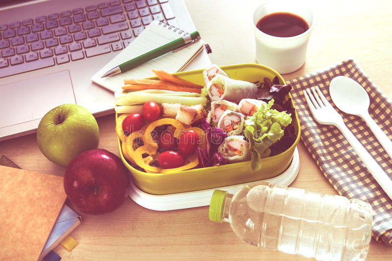Close up green Lunch box on the work place of working desk ,Healthy eating clean food habits for diet and health care concept. Close up green Lunch box on work royalty free stock photography