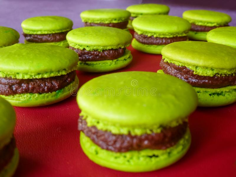 Close up of green macarons prepared for sale in the bakery shop. royalty free stock photo