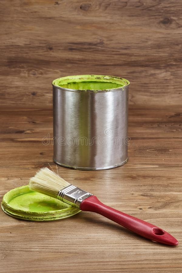 Close-up of a green paint can and brush royalty free stock photo