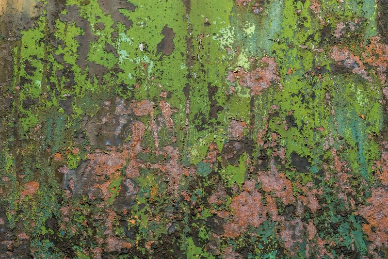 Colorful dilapidated wall textured grunge background. Close up of a green and red dilapidated wall textured grunge background royalty free stock images