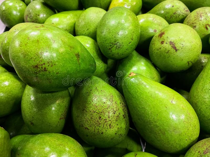 Close-up of green and ripe avocados. Healthy food and nutrition with good fats. stock photo