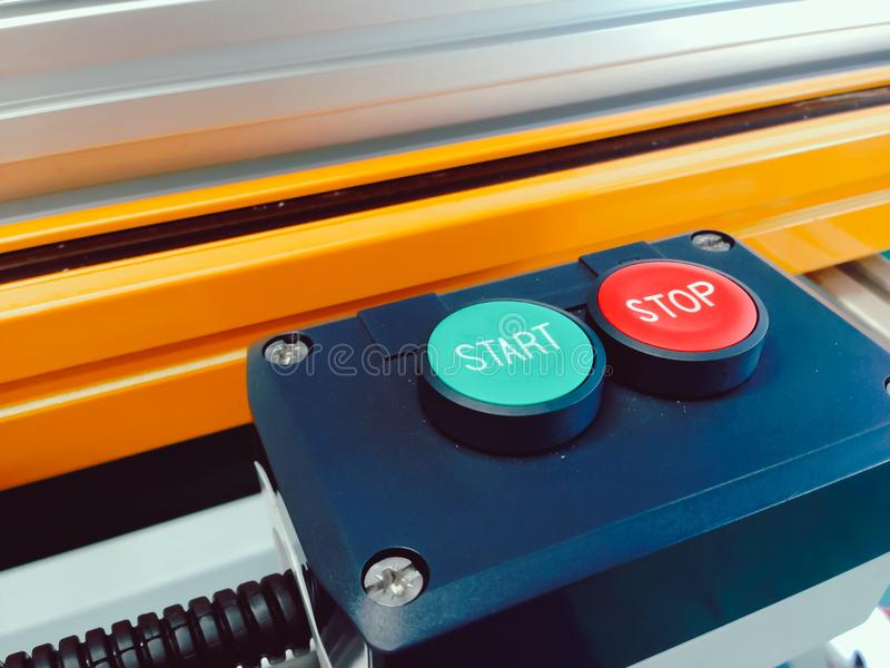 Close up green start and red stop of switch button set design in. Block control with sensor panel for automation system machine use in manufacturing royalty free stock image