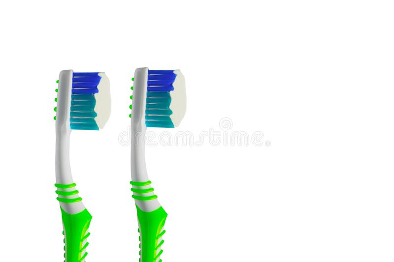 Close up green toothbrush with white creamy toothpaste isolated on white. Close up Green toothbrush with white creamy toothpaste isolated on white background royalty free stock photo