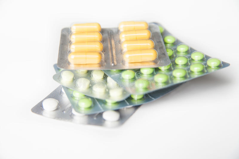 Close-up of green and white pills in blisters royalty free stock photography