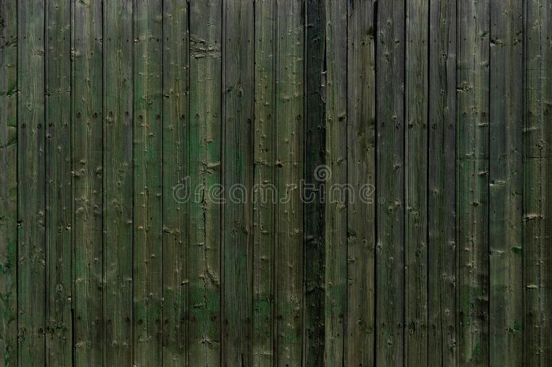 Close up of green wooden fence panels royalty free stock photos