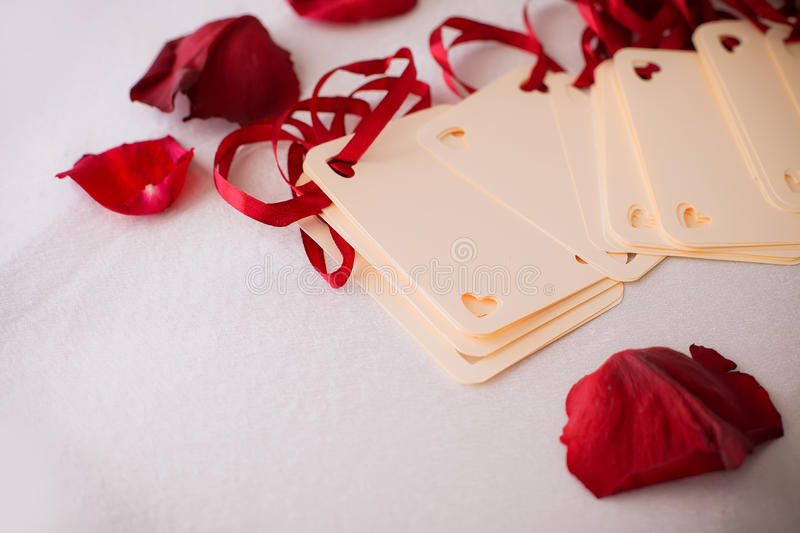 Close up of greeting card with rose petals. Close up of greeting card stock photos