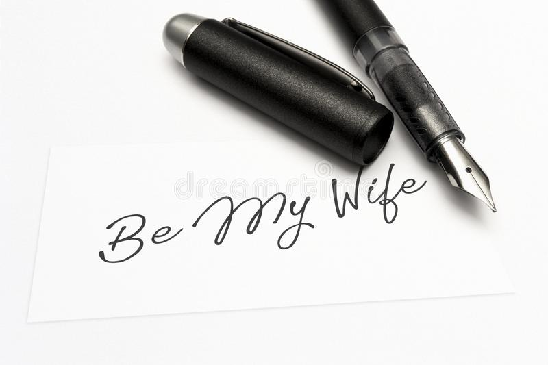 Close-up of a greeting card with the sweet word, be my wife stock image