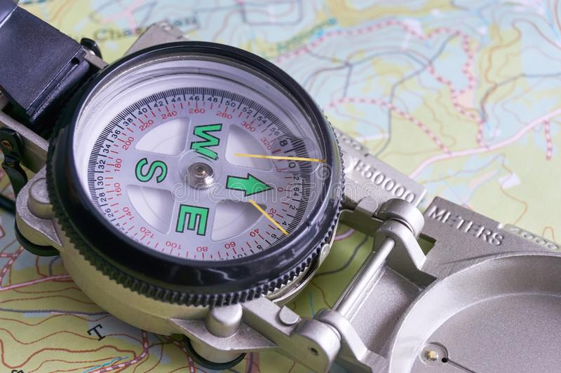 Close-up of military compass on map. Close-up of grey metal military compass on map stock image