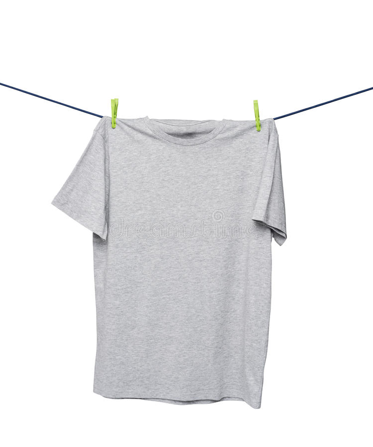 Close up of a grey t-shirts on the rope. royalty free stock images
