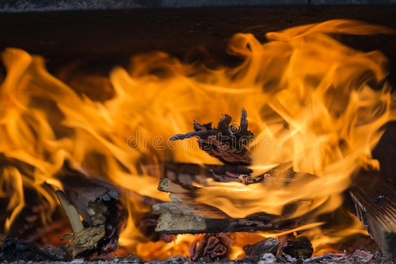 Grill construction, with yellow and red fire flames. Close up of grill construction, with yellow and red fire flames royalty free stock photo
