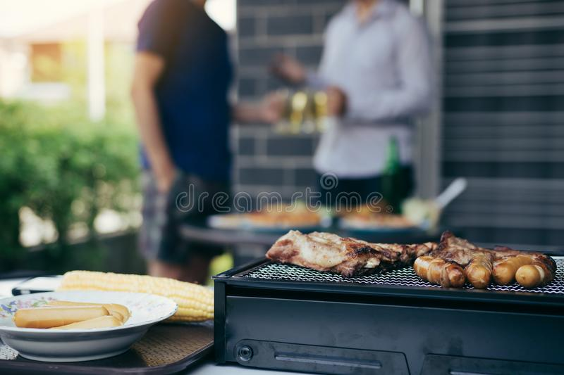 Close up grill with meat and sausage ready for socializing celebrate with friends at outsite home stock photography