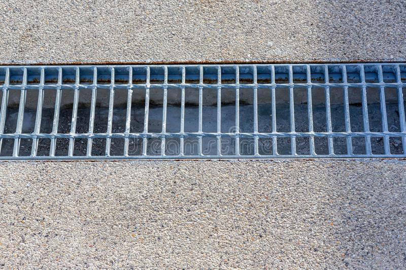 Close up Grille drain of sewer around the street or walkway . stock images