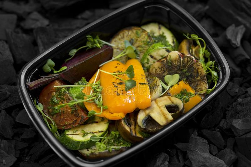 Close up of grilled freshly cooked vegetables in take away box stock photos