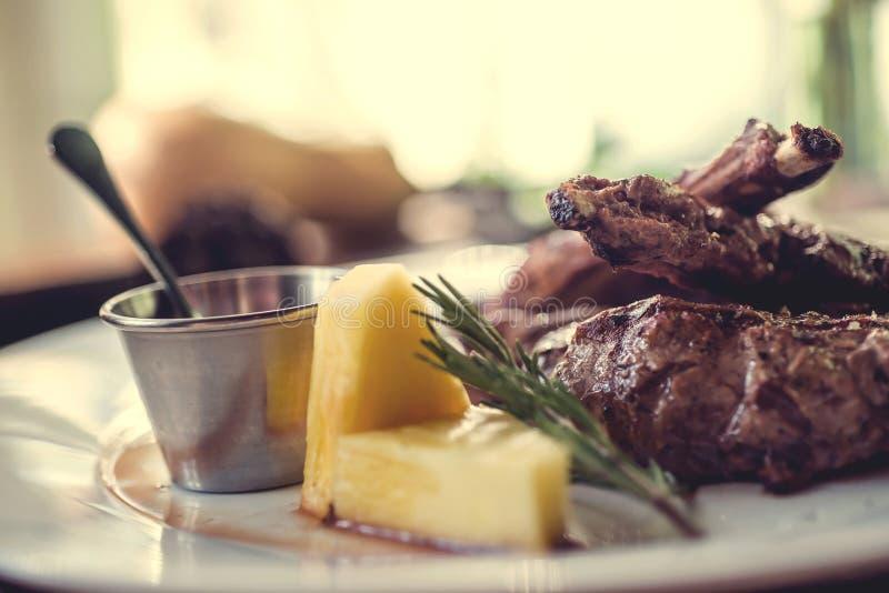 Close up of grilled pork ribs with lemon, sauce stock photos