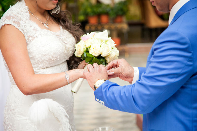 Close up Groom Put the Wedding Ring on bride stock photography