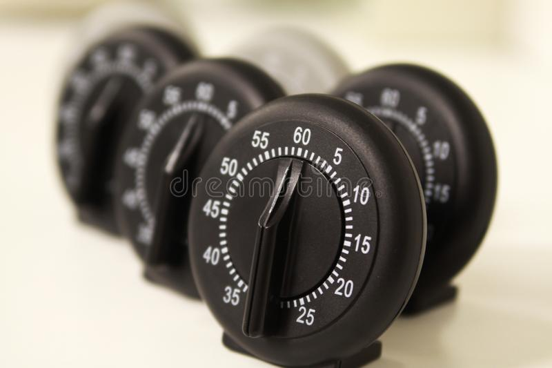 Close up of a group of analog stop watches stock photo