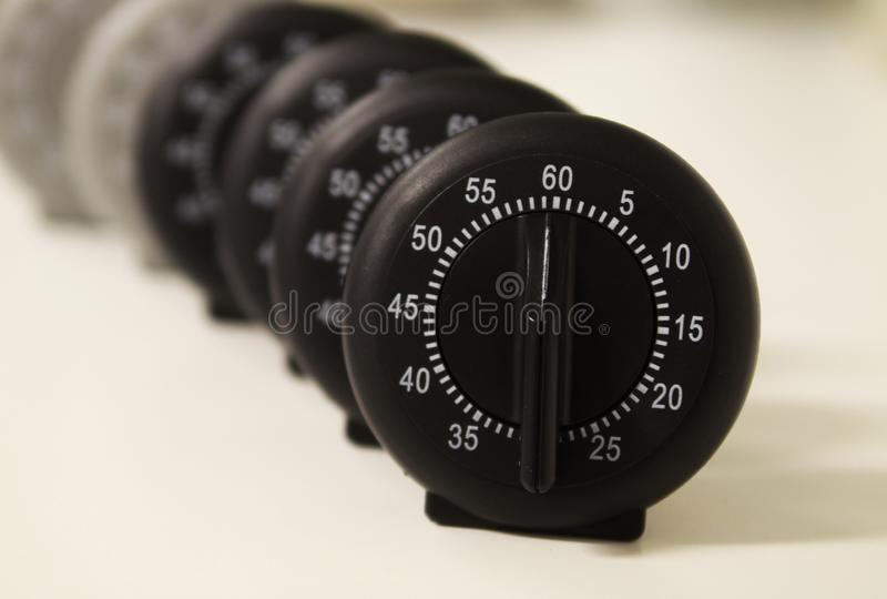 Close up of a group of analog stop watches royalty free stock photo