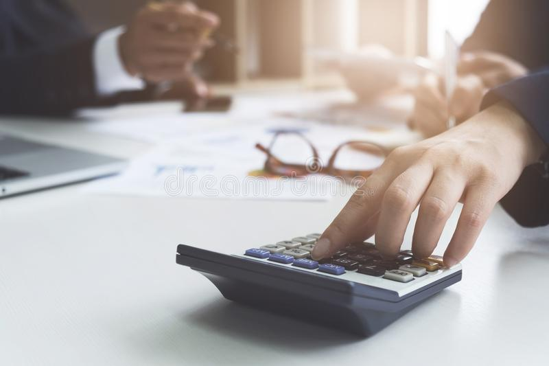 Close up group of business calculator and laptop for calaulating finance, tax, accounting, statistics and analytic research stock photography
