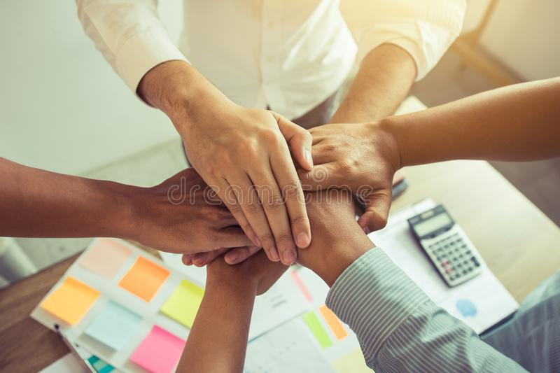 Close up of group of business people joining their hands together in unity royalty free stock photos