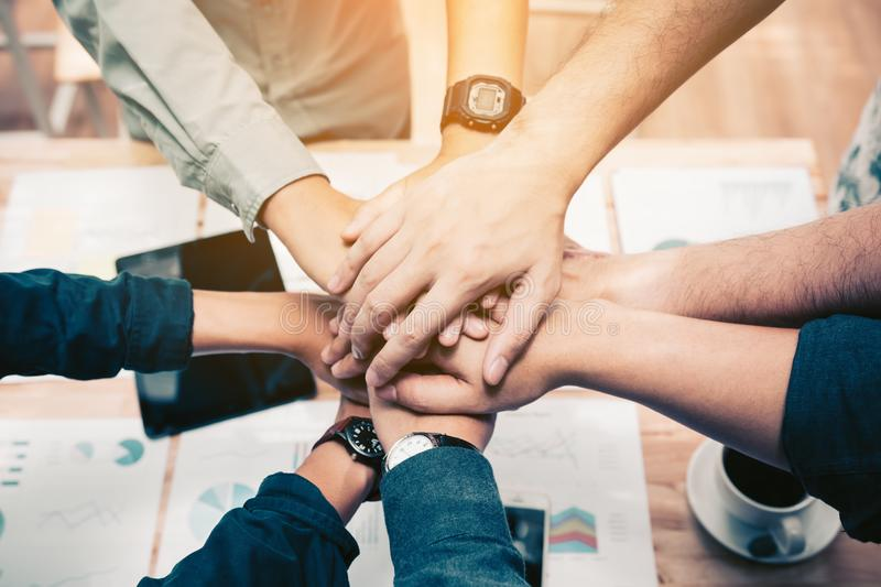 Close up of group of business people joining their hands togeth stock photo
