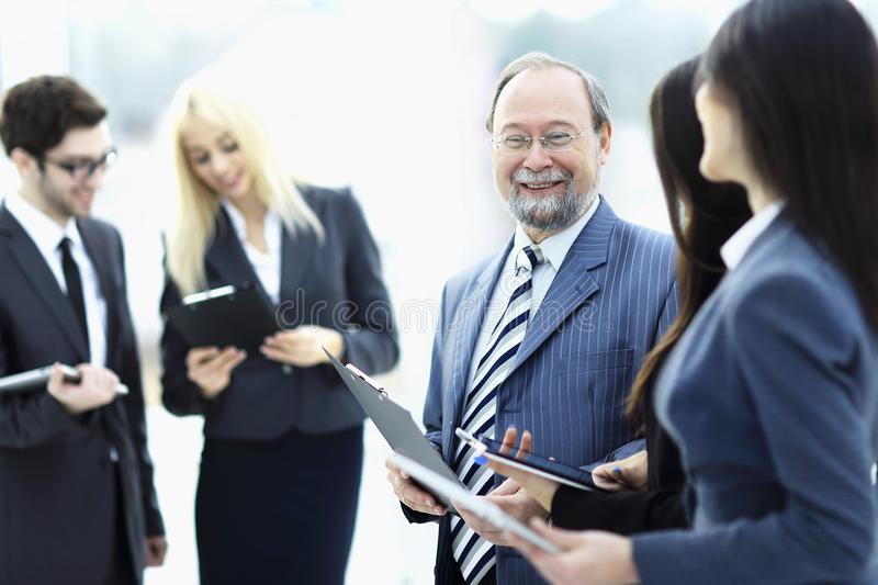 Close up.group of business people standing in lobby of office. stock photos