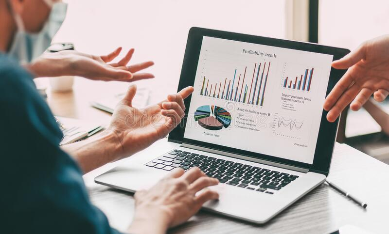 Close up. group of employees discussing financial data. royalty free stock images