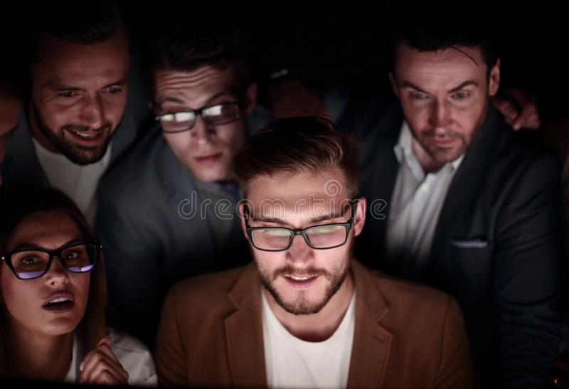 Close up.a group of employees working in the office late stock images
