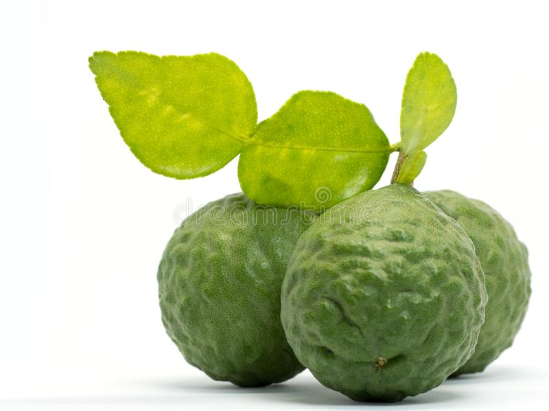 Close up group of fresh bergamot with green leaves isolated on white background. benefits of bergamot for beauty and health concep stock image